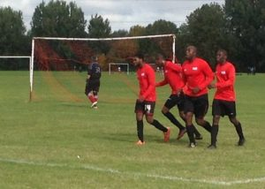 Badu players celebrate Nana screamer against Clerkenwell